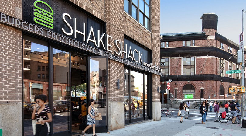 Shake Shack store on street corner. Image obtained from Hudson Square Properties