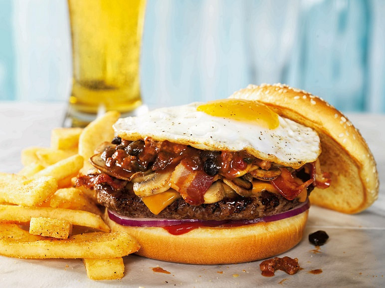 Red Robin Gourmet Burger with fried egg and a beer